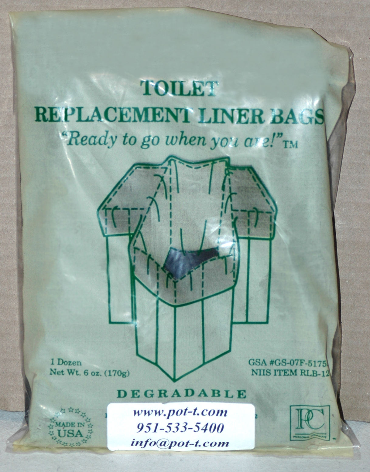 Bag of one dozen biodegradable cornstarch liners, placed in front of a brown cardboard background.